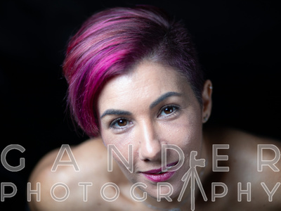 Portrait of Woman with short purple hair